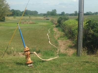 This photo which was widely shared on Facebook shows a hose for irrigation connected to a fire hydrant without a backflow prevention device by the hydrant. It shows a hydrant on Fancher Road in Murray.