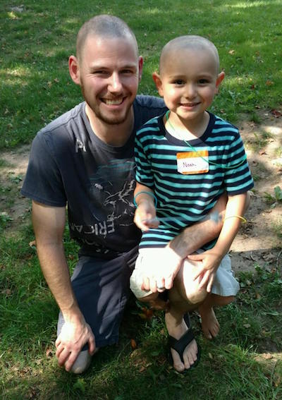 Jesse Dole and his son Noah, 4, of Albion are all smiles after getting their hair cuts at the Bald for Bucks event. Jesse's wife and Noah's mother Ashley helped put on the event. and No