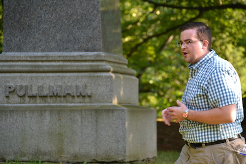 Matt Bullard stops at the Pullman family grave at Mount Albion on Sunday. James Lewis Pullman, father of sleeping car magnate George Pullman, is buried at Albion's historic cemetery.