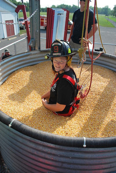 Provided photo: Kara Bentley of the Barre Volunteer Fire Company portrays a trapped firefighter in a grain bin during a training exercise Aug. 20 at Carlton.