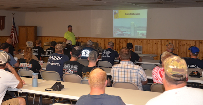 Dan Neenan, an instructor with the National Education Center for Agricultural Safety, discusses grain bin safety and rescue during an Aug. 20 trainign class at the Carlton Recreation Hall.
