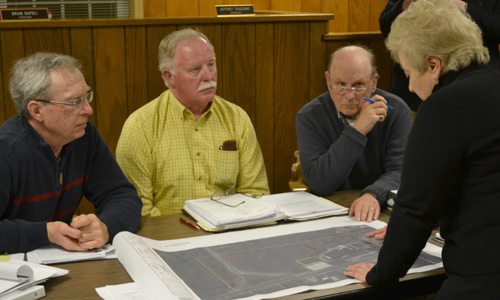 Gabrielle Barone in February 2014 discusses a plan for a 48,000-square-foot addition at Brunner with Town of Ridgeway Planning Board members, from left: Charles Pettit, Tom Fenton (chairman) and Richard Swan. Barone in her role with the EDA needs to line up local support and approval for many of the economic development projects in the community.