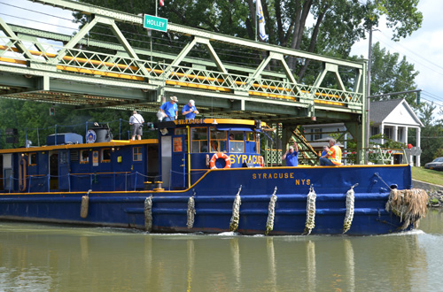 File photo by Tom Rivers: The Tug Syracuse carries inspectors and officials from the State Canal Corporation after checking the lift bridge in Holley in August 2014. Canal inspectors will be in Orleans today to check hydraulic, mechanical and electrical on the lift bridges