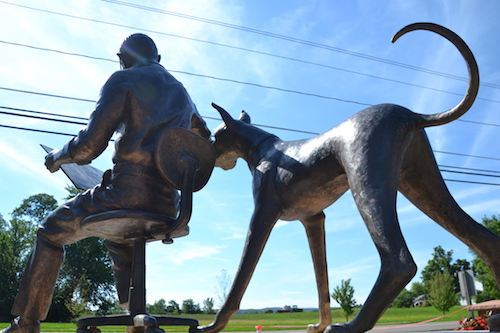 Marmaduke is poised and ready to play in the statue created by Don Sottile.