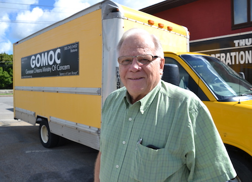 Photo by Tom Rivers: Laverne Bates executive director of the Genesee-Orleans Ministry of Concern, stands by the furniture truck that has been sidelined due to engine trouble, bad brakes and other breakdowns.