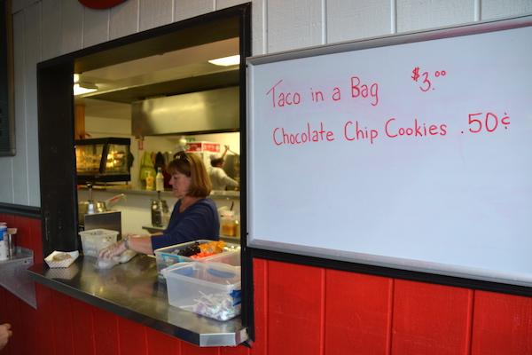 Roxanne Wagner is at the front window getting an order. It was fast-paced for the volunteers in the concessions last night.
