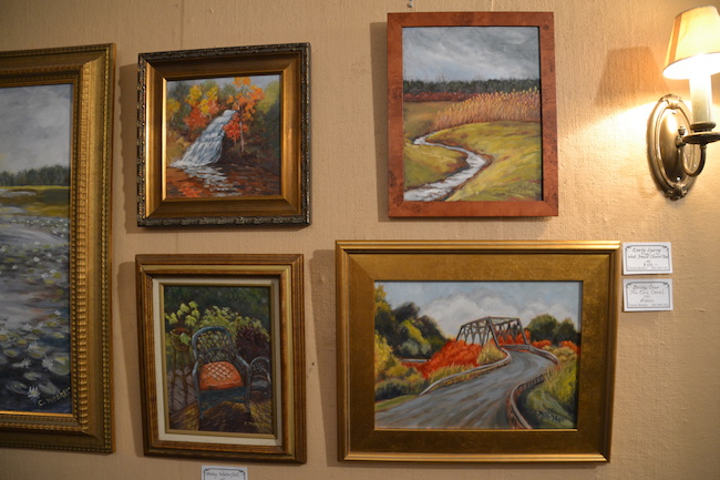 These four paintings include (clockwise from top right): Early Spring on West Transit Church Road, Bridge Over The Erie Canal , The Wicker Chair, and Holley Waterfall.