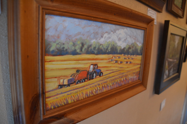 "Many of Mosher's paintings show local farms, including this one entitled, ""Baling Straw."" Mosher lives on West Transit Church Road with her husband John, a retired professor from Brockport State College. They raised four kids out in the country. ""The rural landscape is very beautiful."""