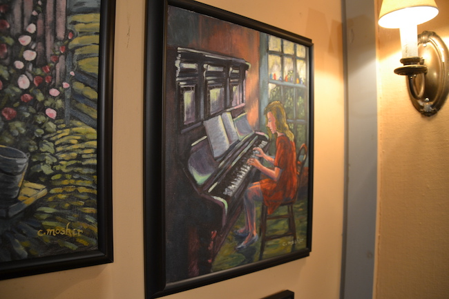 """Afternoon Practice"" depicts a girl playing the piano."