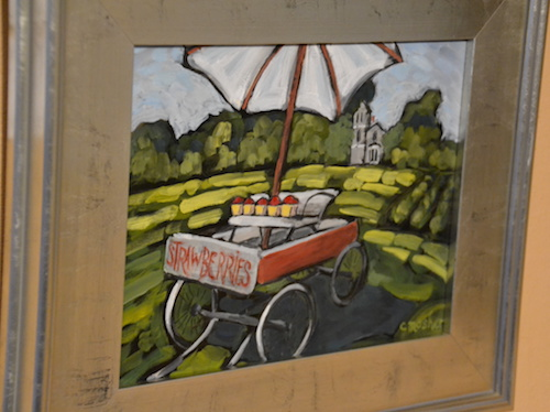 """Strawberries for sale"" is a painting at Chad and Alana Fabry's in Holley, showing strawberries for sale on a wagon."