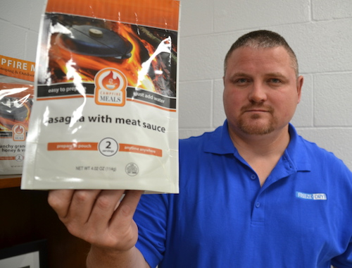 Matt beadle holds a new Campfire Meals product line launched last year by Freeze-Dry. The meals are in pouches and are ready by simply adding hot water.