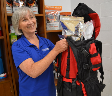 "Karen Richardson holds a popular Freeze-Dry product: an emergency ""Bug-out bag"" that has a backpack, emergency food supply, and gear for short-term survival situations."