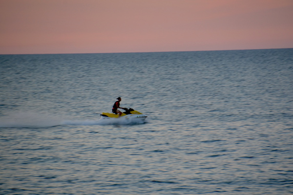 This Jet Ski rider enjoys a trip on Lake Ontario on Sunday evening.