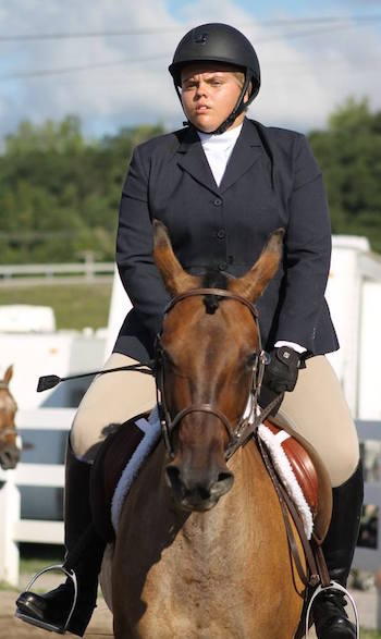 Photo courtesy of Marlene Seielstad: Kaitlin Zwifka of Albion won a ribbon for a horse-riding event at the State Fair.