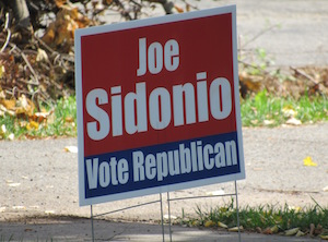 Joe Sidonio forced a primary and has signs out urging support on Tuesday during the primary.