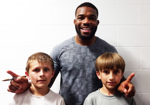 Provided photo: Jordan Burroughs, an Olympic champion wrestler, is pictured with two Medina wrestlers in the modified program: Dominick Callara, left, and Logan Callara.