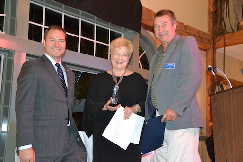 Gabrielle Barone accepts her award with congratulations from State Sen. Robert Ortt, left, and Barry Flansburg, representing State Assemblyman Steve Hawley.