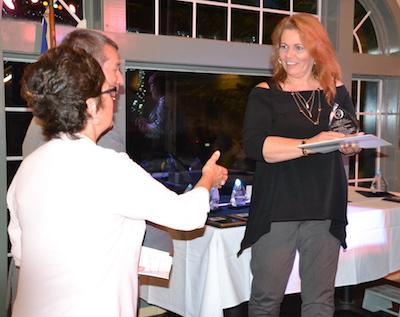 Cindy Robinson accepts the Community Service Award.