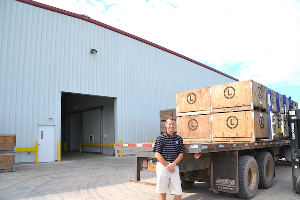 Ward Dobbins is pictured outside the 26,240-square-foot controlled atmosphere storage building that opened last year on Millers Road.