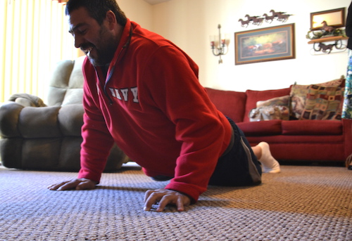 Photos by Tom Rivers: Chris Caldwell does a push-up on Tuesday. He works hard in physical therapy and doing daily exercises to regain strength and mobility. His left leg was amputated from just above the knee.