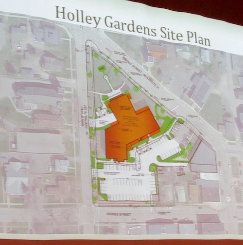 Developers presented a proposed site plan which includes parking to be owned and maintained by the Village of Holley. Mayor Brian Sorochty said there will be spaces for residents and unused spaces will be available for public use. Note the short driveway and parking off Main Street towards the front of the building for the village offices which will be housed in the front of the school.