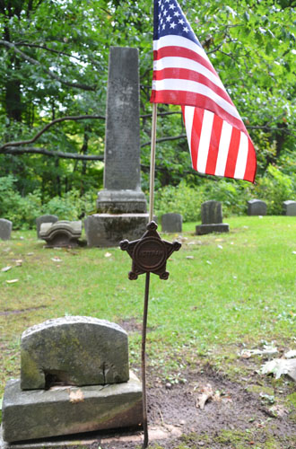 File photo by Tom Rivers: Herbert Charles Taylor is buried at Hillside Cemetery. This photo shows his grave, which is in the historic section of the cemetery.