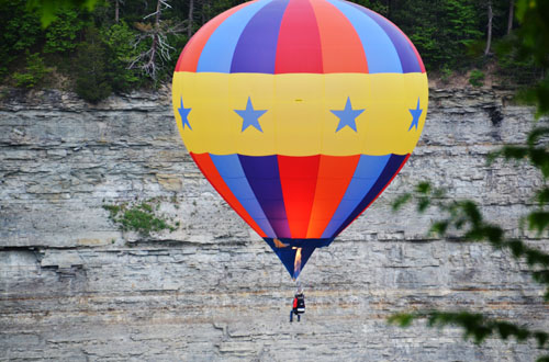 A hot air balloon takes off at Letchworth State Park in this photo from May 2015. Wyoming County has numerous signs in many towns pointing people to the park.
