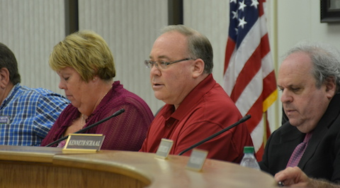 File photo by Tom Rivers: Shelby Town Supervisor Skip Draper leads a public hearing on Sept. 7 about a proposed overlay district near the wildlife refuge that would ban a quarry and many other uses viewed by town officials as incompatible with the wildlife refuge. Shelby Town Clerk Darlene Rich is at left and attorney Dan Spitzer is at right.
