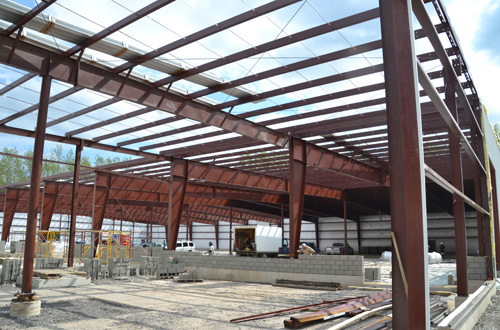 There were some positives in the latest poverty report about Orleans County, including growth in manufacturing jobs. This photo from September 2014 shows a 48,000-square-foot addition taking shape at Brunner International in Medina.