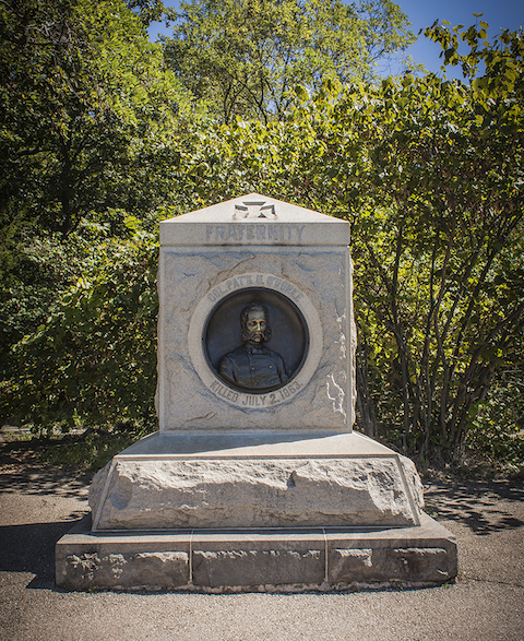 Photos by Matt Ballard: The monument to Col. Patrick Henry O'Rorke features a bas-relief set in granite. Standing over eight feet tall, the marker rests atop the spot where O'Rorke was killed. His nose is polished as a result of visitors rubbing it for good luck, although he had little luck himself that day.