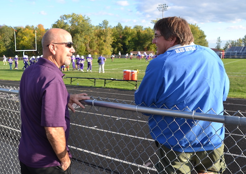 Dan Monacelli, left, chats with Wayne Wadhams during the modified football game in Albion on Wednesday when seventh- and eighth-graders from Albion played a team from Cheektowaga.