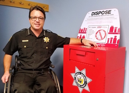 Provided photo: Orleans County Sheriff Randy Bower is pictured with the prescription drug drop box at the Public Safety Building in Albion. That spot is available for people to drop off unused prescription drugs during normal business hours.