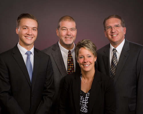 Photo courtesy of Bruce Landis: Christopher Mitchell Funeral Homes in Albion and Holley has four full-time funeral directors, from left: Josh Mitchell, Scott Schmidt, Paula Fuller and David Mitchell.