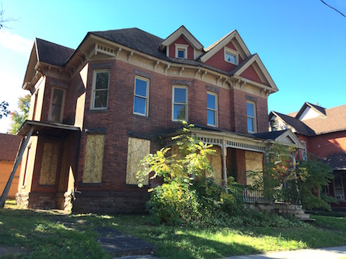 """Photo by Tom Rivers: This home on West State Street, behind the Post Office, is one of 43 houses in the Village of Albion considered a """"zombie"""" property with no clear owner."""