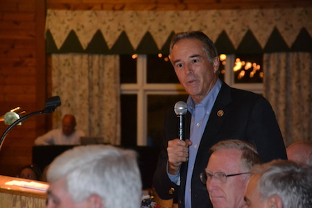 Chris Collins, R-Clarence, addresses about 200 people at the Republican rally. Collins in April was the first member of Congress to endorse Donald Trump for president.