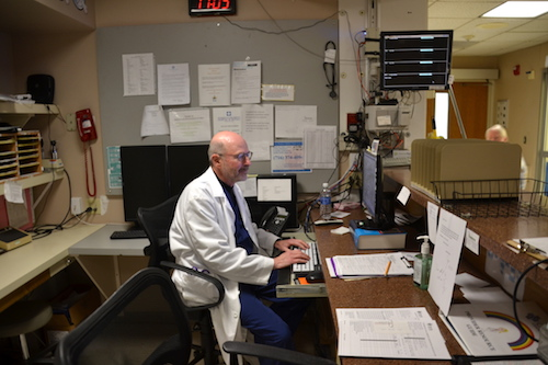 Dr. Richard Elman enters data into the computer in the Emergency Room at Medina Memorial Hospital.