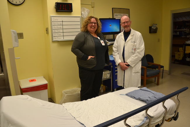 MacKenzie Smith and Dr. Richard Elman are pictured in one of the trauma rooms with a new mounted computer, which makes it quicker to enter and check medical data.
