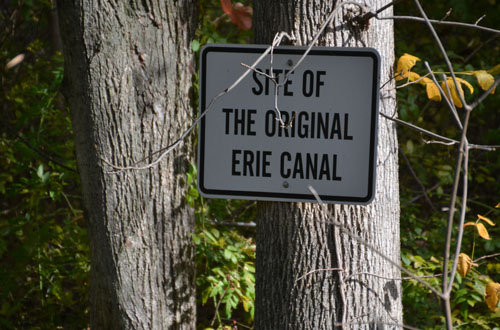 Holley has the only original section of the Erie Canal remaining from between Buffalo and Rochester. A humble sign nailed to a tree notes that distinction.