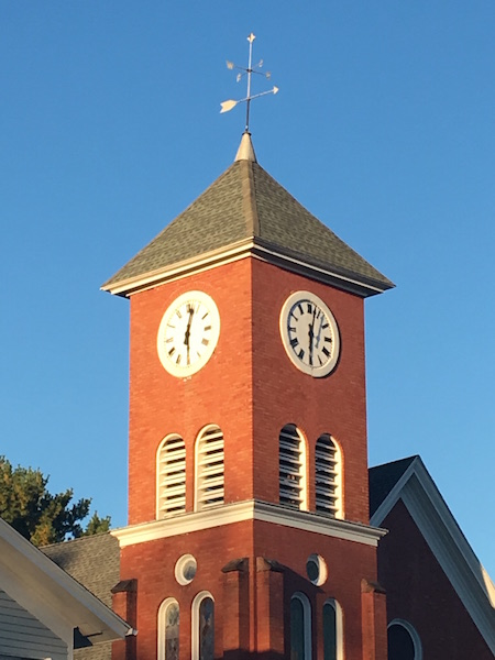 Photo by Tom Rivers: A former United Methodist Church in the Public Square at Holley is pictured recently. The church is now used for apartments. The clock faces were restored last year.