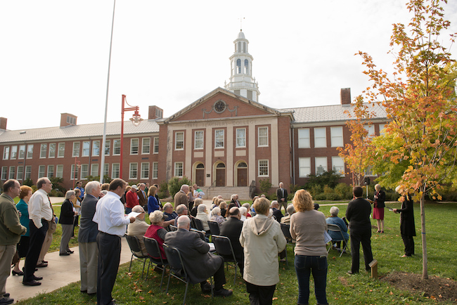 The tree is planted on the front lawn of Hartwell Hall.