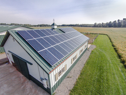 Photo – Solarize Orleans: A barn on Eagle Harbor Road in Albion has solar panels mounted on the roof.