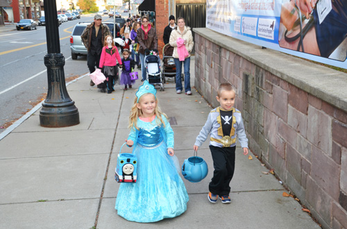 File photos by Tom Rivers:Princesses, ghosts, clowns and other creatures will be in downtown Albion and Medina on Friday for the annual Beggar's Night events.Merchants at both downtowns will be handing out candy. This photo from October 2014 shows cousins Maria Bregy, a princess, and Anthony Love, a Power Ranger, walking up East Center Street in Medina by Rotary Park.