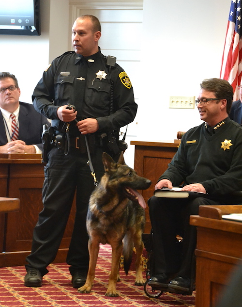 Deputy Jeff Cole said Otto will be an asset for local law enforcement. Sheriff Randy Bower is at right and Chuck Nesbitt, the county's chief administrative officer, is at left in back.