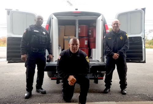 Provided photo: The Orleans County Sheriff's Office has unused medication boxed u and ready to be delivered to an incineration facility after the Drug Take-Back Day last Saturday. Pictured, from left, include: Christopher Shabazz, a correctional officer at the county jail; Scott Wilson, jail superintendent; and Michael Mele, chief deputy.