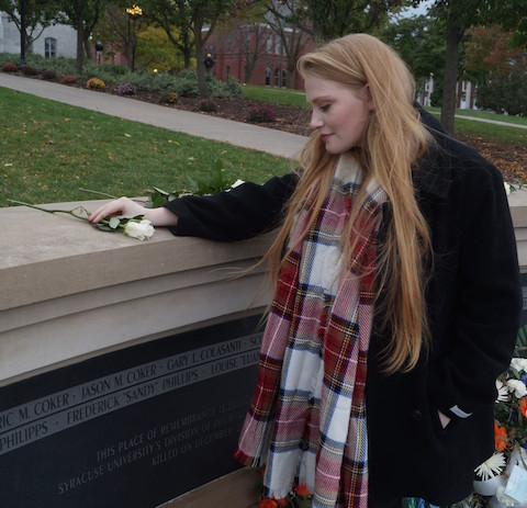 """Joyce LaLonde is pictured at The Place of Remembrance at Syracuse on Friday where there was a memorial service and rose-laying ceremony. LaLonde is one of 35 Remembrance Scholars. The scholarships are a tribute to the 35 Syracuse students killed in the Dec. 21, 1988, bombing of Pan Am Flight 103 over Lockerbie, Scotland. LaLonde was awarded her scholarship in memory of Frederick """"Sandy"""" Phillips."""