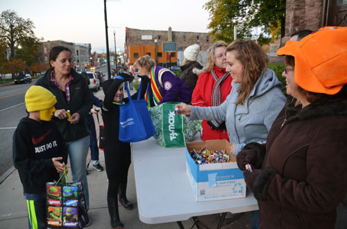 This photo from October 2015 shows members of the Albion Teachers Association handing out candy in front of the First Presbyterian Church. The teachers include, from right to left: Janet Husung, Stephanie Schepis, Mary Jane Klips, Juie Keller and Dawn Squicciarini (in purple).