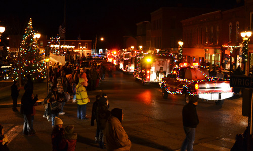 File photo by Tom Rivers: Holley's Parade of Lights passes through the Public Square in this photo from December 2013. The village is seeking community volunteers to help bring back the event, and work on the June Fest as well.