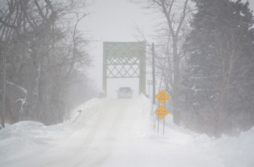 File photo by Tom Rivers: A truck heads south on Gaines Basin Road to cross the canal bridge in this photo from February 2015.