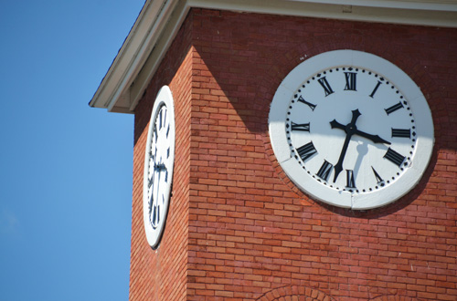 File photo by Tom Rivers: The four clock faces on the dominant church tower in Holley's Public Square were fixed last year by Glenn Hughson, owner of the former United Methodist church building which is now used for apartments. Clocks will need to be turned back for Daylight's Savings Time.