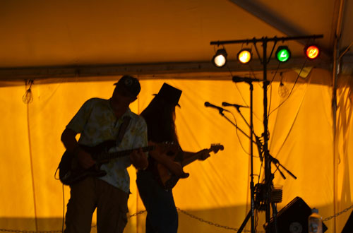 File photos by Tom Rivers: John Borello, left, and Ed Hilfiker, guitarists with The Who Dats, perform during the Orleans County 4-H Fair in this photo from July 2015. If the Orleans County Cornell Cooperative Extension is approved for a state grant, the main performing stage would shift to the Curtis Pavilion, rather than the temporary stage shown here.